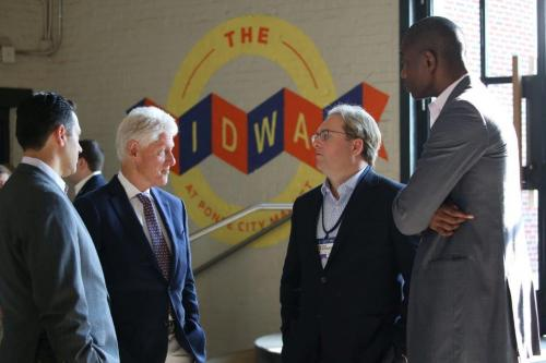 Chad Brownstein chats with President Bill Clinton and former NBA star Dikembe Mutombo
