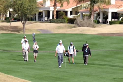 Chad Brownstein walks down the fairway during the Humana Challenge